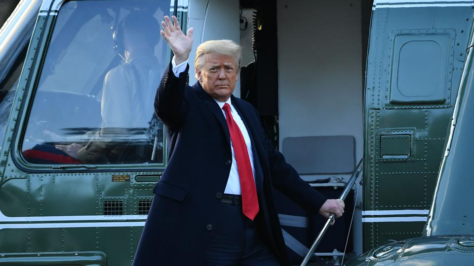 Trump waves goodbye departs White House on Marine One