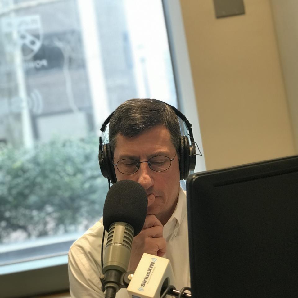 Loren Feldman recording a podcast episode in a Sirius radio studio.