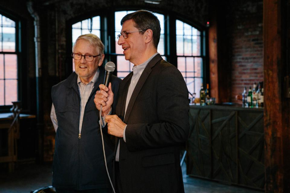 Loren Feldman and Bo Burlingham celebrate purpose-driven business leaders at the Forbes Small Giants award ceremony during the Small Giants Community Summit.