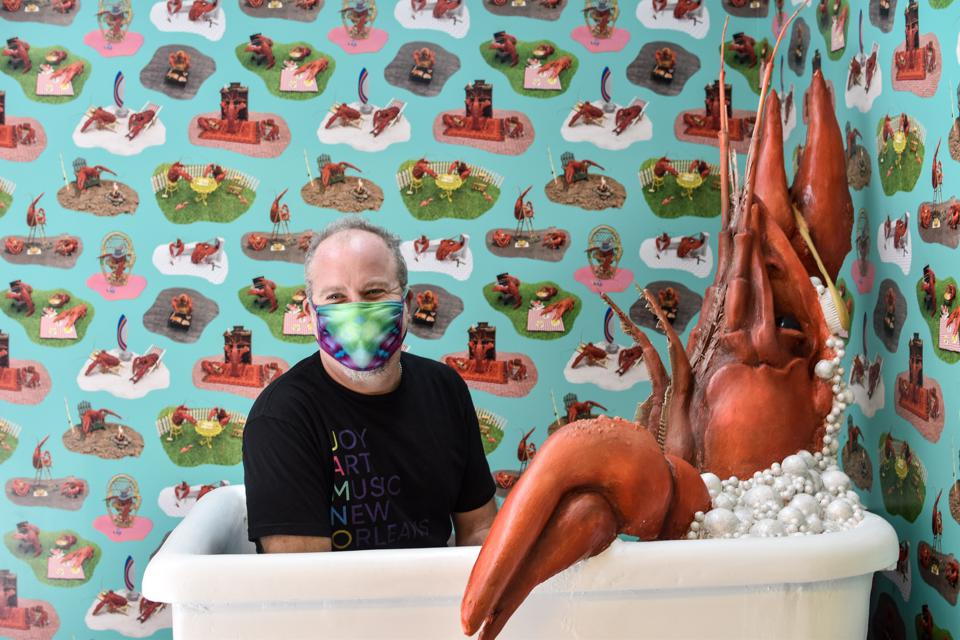 JAMNOLA: A man sits in a bathtub with a giant crawfish