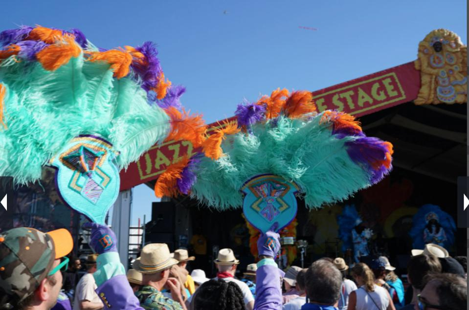 Waving pompons at Jazz Fest, New Orleans