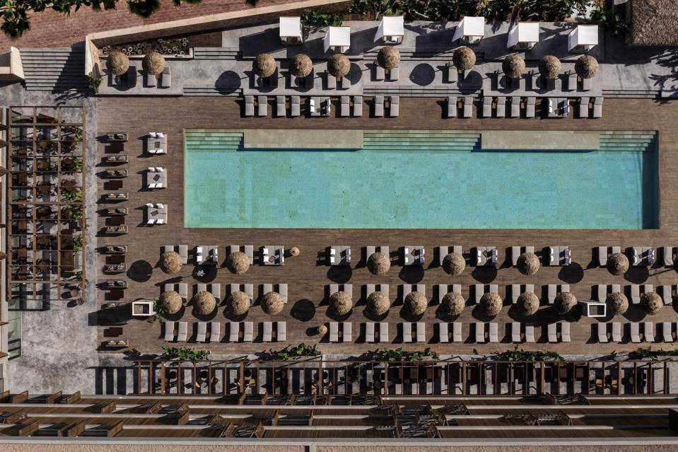 Aerial view of swimming pool area at OKU Ibiza luxury boutique hotel Ibiza Spain