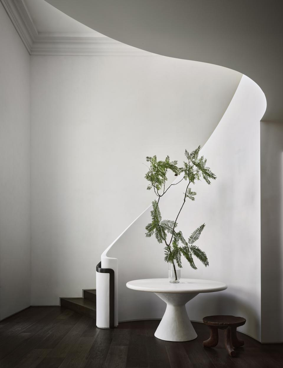 A sweeping, stark-white staircase.