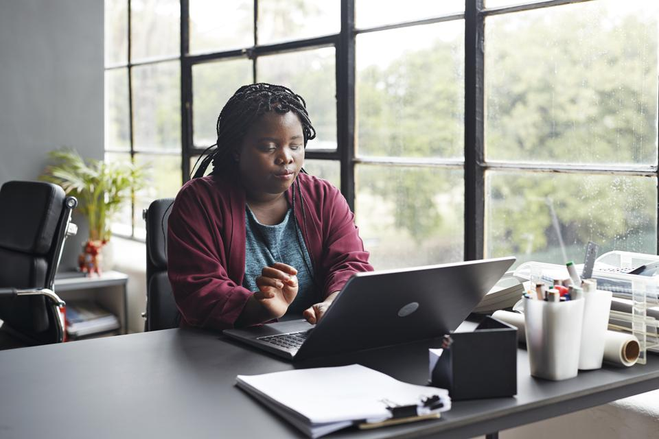 Female professional working at a laptop -- career change activity in 30 minutes or less