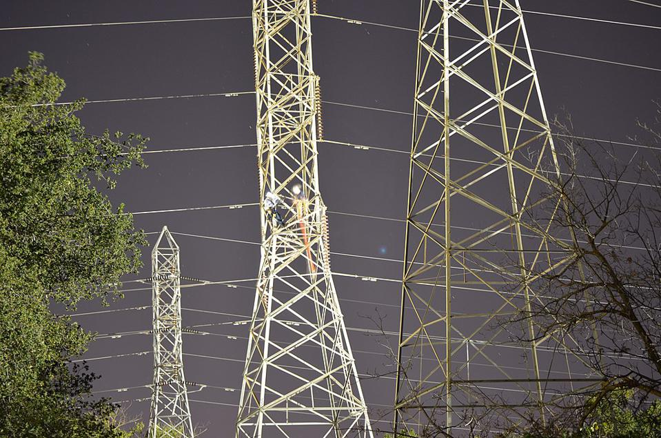 Workers from WAPA de-energize high power lines near Cal State in Sacramento.