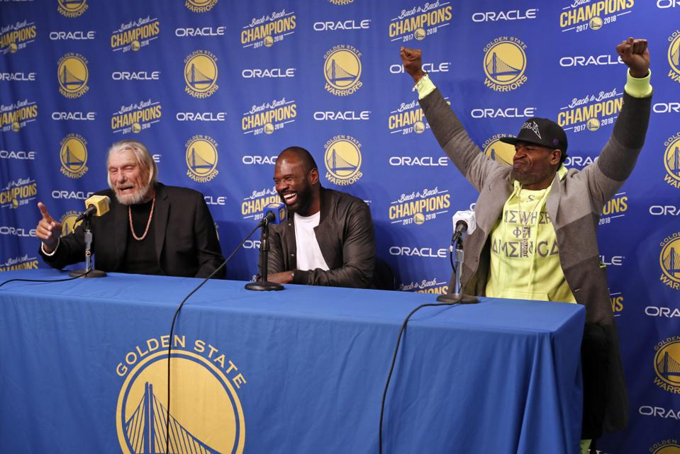 Former Golden State Warriors' Stephen Jackson (right) and Jason Richardson react to Don Nelson saying that he has been smoking pot in retirement during press conference before Warriors play Sacramento Kings in NBA game at Oracle Arena in Oakland, Calif.,