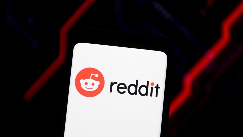 In this photo illustration a Reddit logo seen displayed on a...