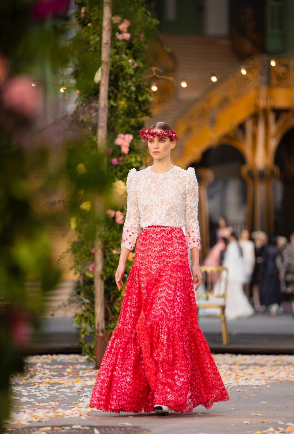 Rebecca Longendyke is wearing a lace white and red ensemble with flower embroidered cuffs
