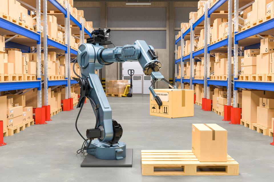 Robotic arm with cardboard box. Automatic warehouse concept. 3D rendering isolated on white background