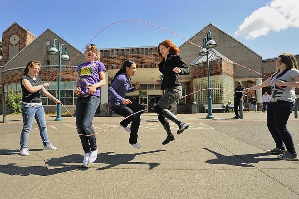 Author Megan Bledsoe plays double dutch with students