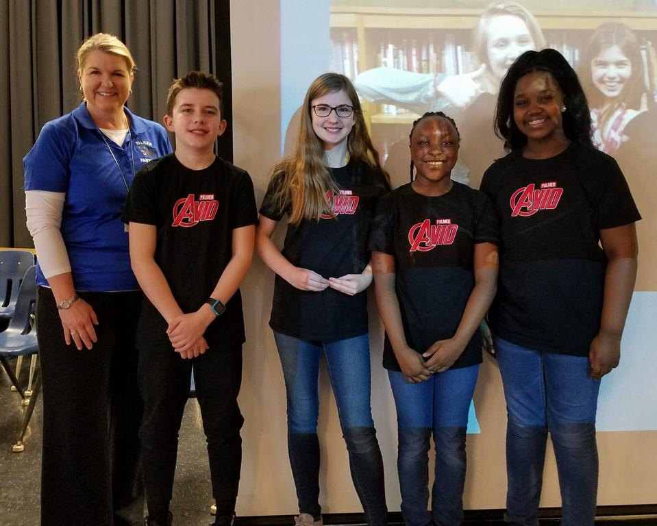 Author Barbara Truluck poses with AVID Ambassadors helping smooth the transition for students to middle school.