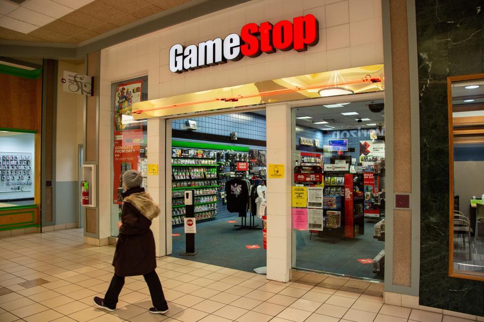 A woman walks past the GameStop store inside the Susquehanna...