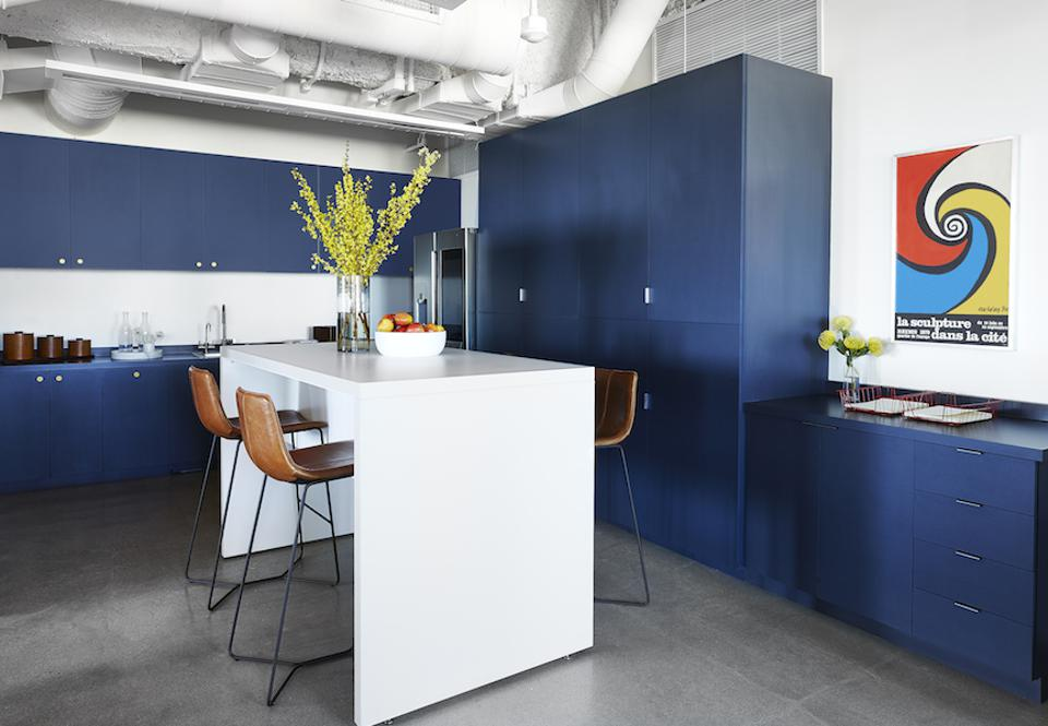 A blue and white office kitchen