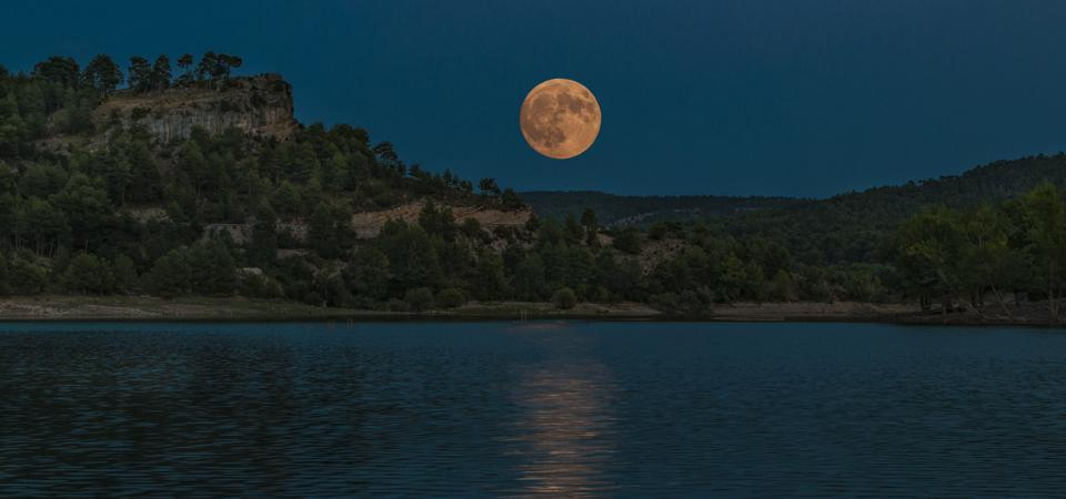 A rising full Moon always appears orange for a few precious minutes.