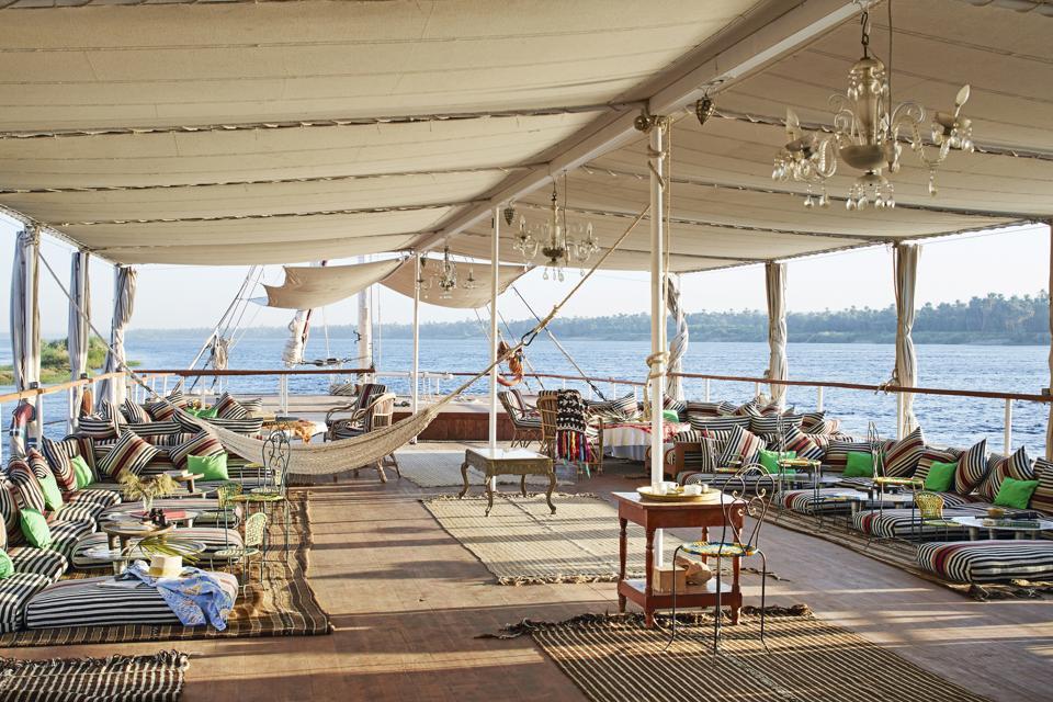 The dahabiyat boat on the Nile River in Egypt is lavish, with hammocks and cushions