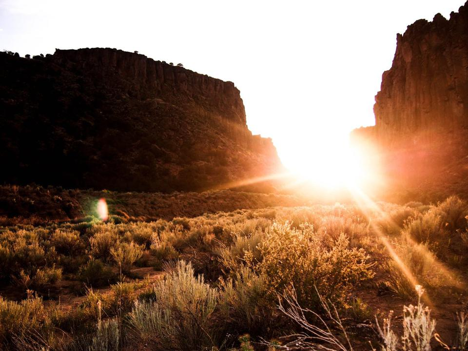 The sun is setting over Diablo Canyon in the mountains of New Mexico, USA