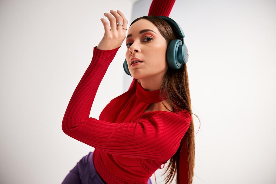 Woman wearing Miami Teal headphones
