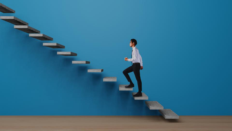 Side View Of Businessman Climbing On Steps