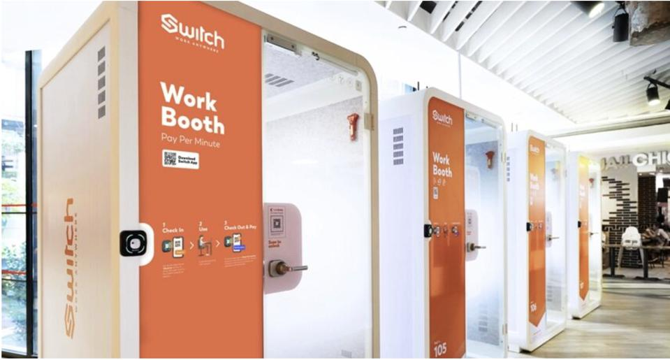A row of Switch booths outside a department store