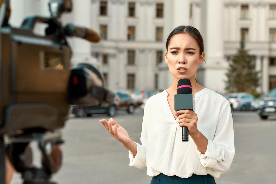 The whole truth and nothing but the truth. TV reporter presenting the news. Journalism