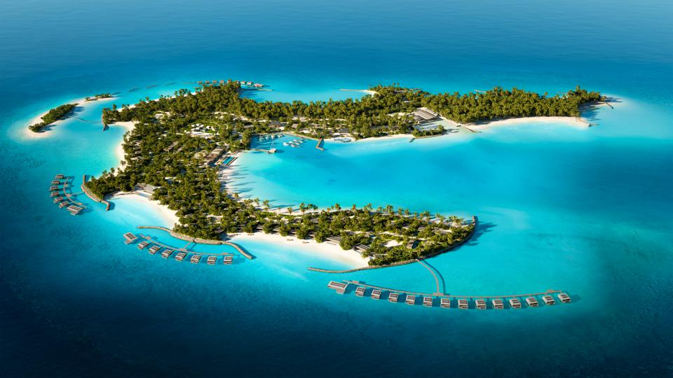 A palm-tree covered island with several white sand beaches in an aquamarine sea. Three groupings of overwater villas branch out from docks.
