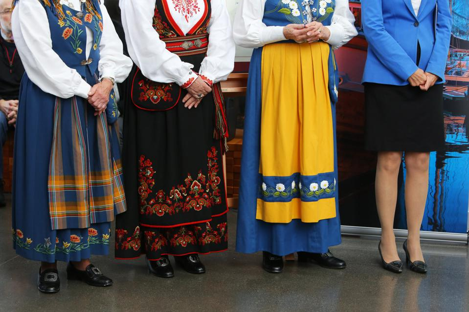 Community guests and dignitaries participate in a ceremony at the National Nordic Museum.