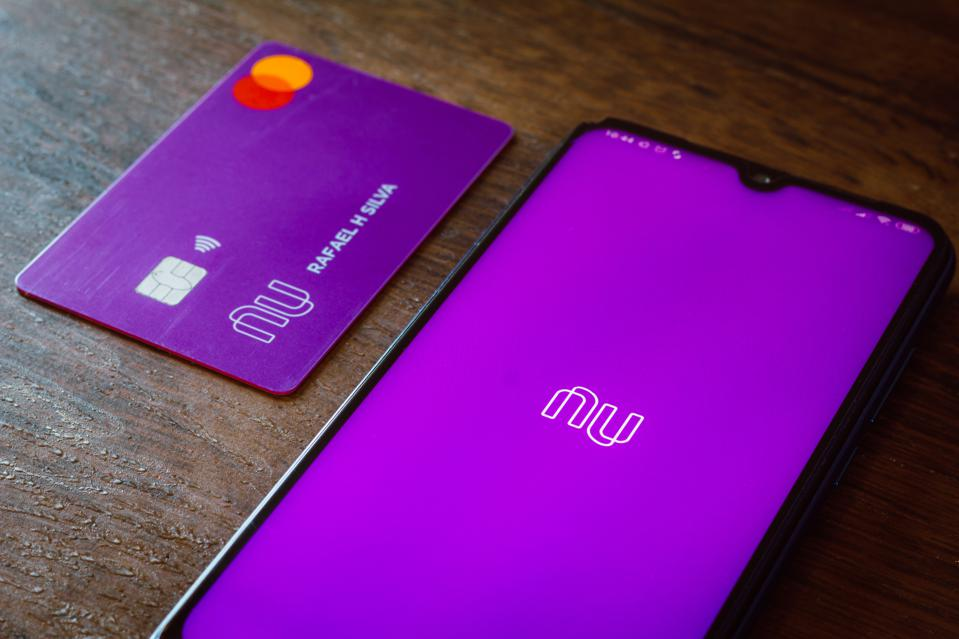 In this photo illustration the Nubank logo seen displayed on...