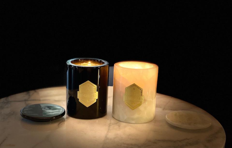 black and white marble candles burning on a table