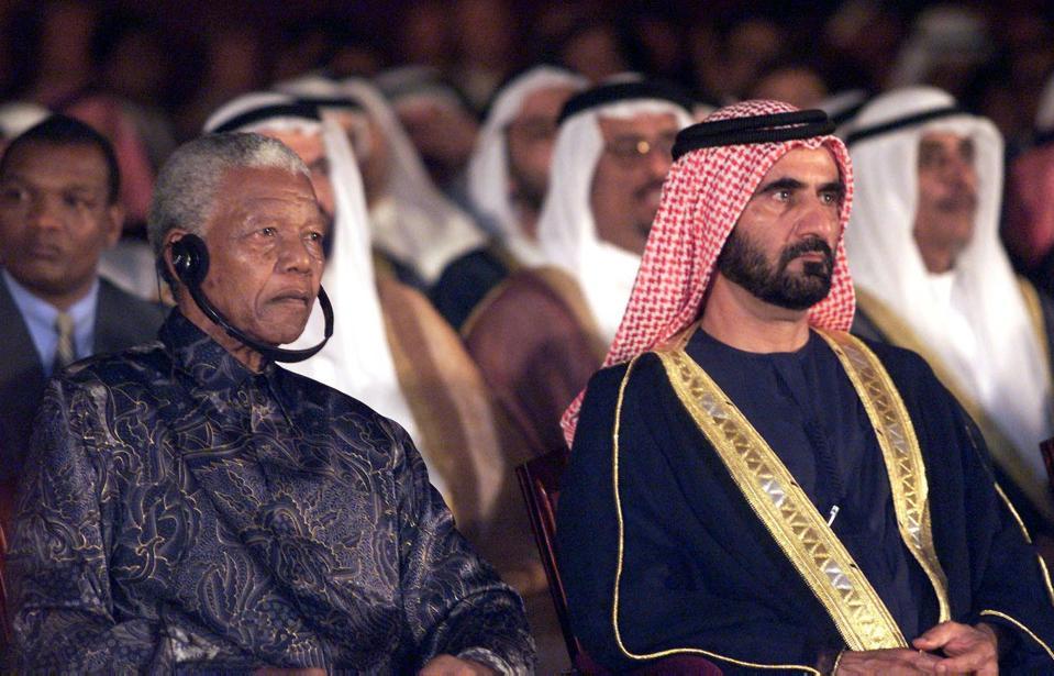 Former South Africa president Nelson Mandela (L) a