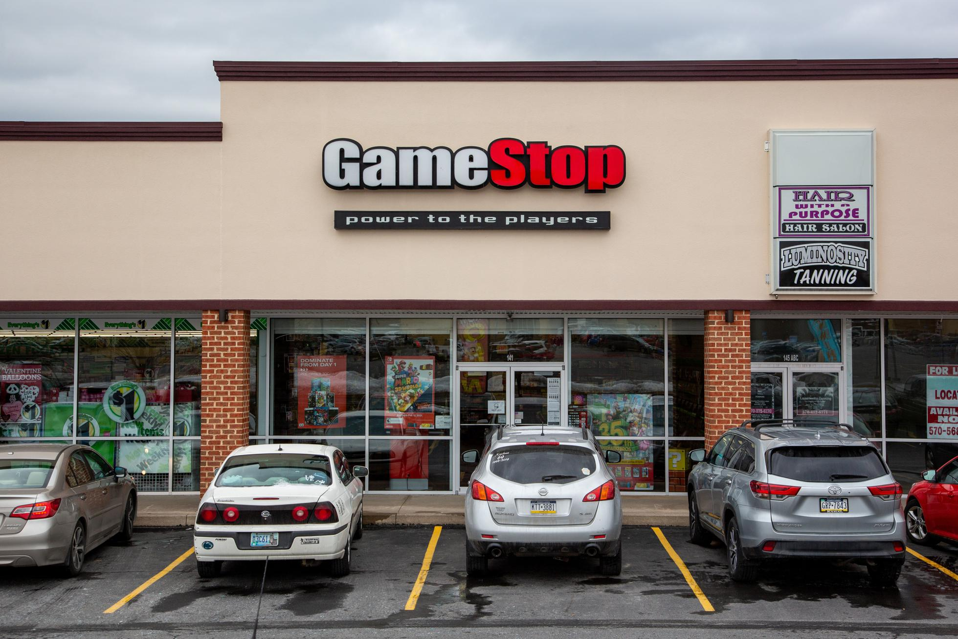 Vehicles seen parked in front of the GameStop store at the...