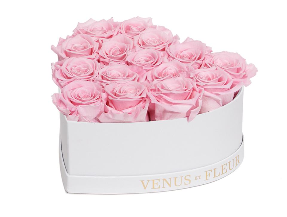 white heart shaped box of pink eternity roses