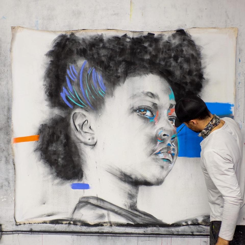 Micah Johnson working on a painting from his ″Black Sheep″ series and exhibition at Art Angeles Los Angeles.