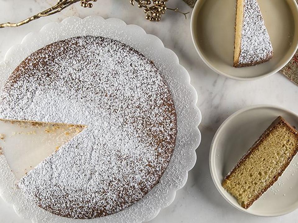 Plated and sliced, powdered sugar sprinkled Greek Vasilopita