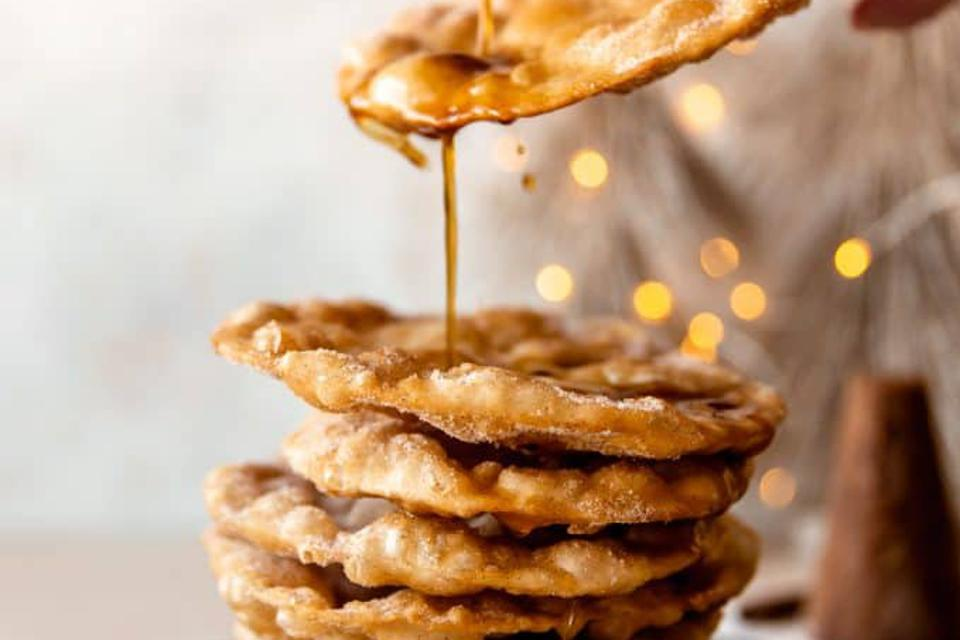Mexican Bunuelos - light, crispy and fried to a beautiful golden brown. Serve coated with cinnamon sugar and drizzled with homemade piloncillo syrup