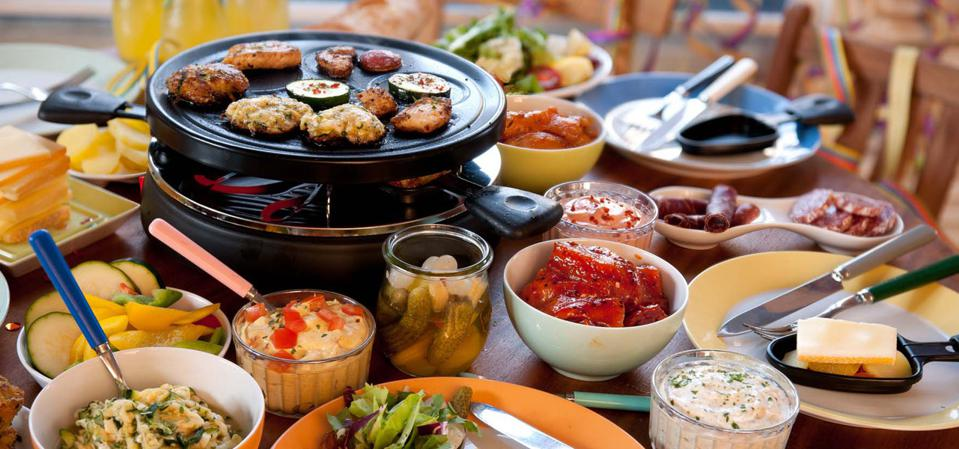 gourmetten is a popular Dutch meal prep method involving a small hot plate/grill on table