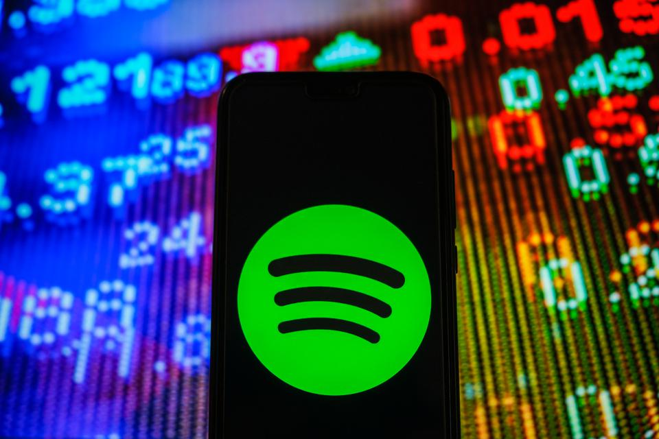 In this photo illustration, a Spotify logo seen displayed on...