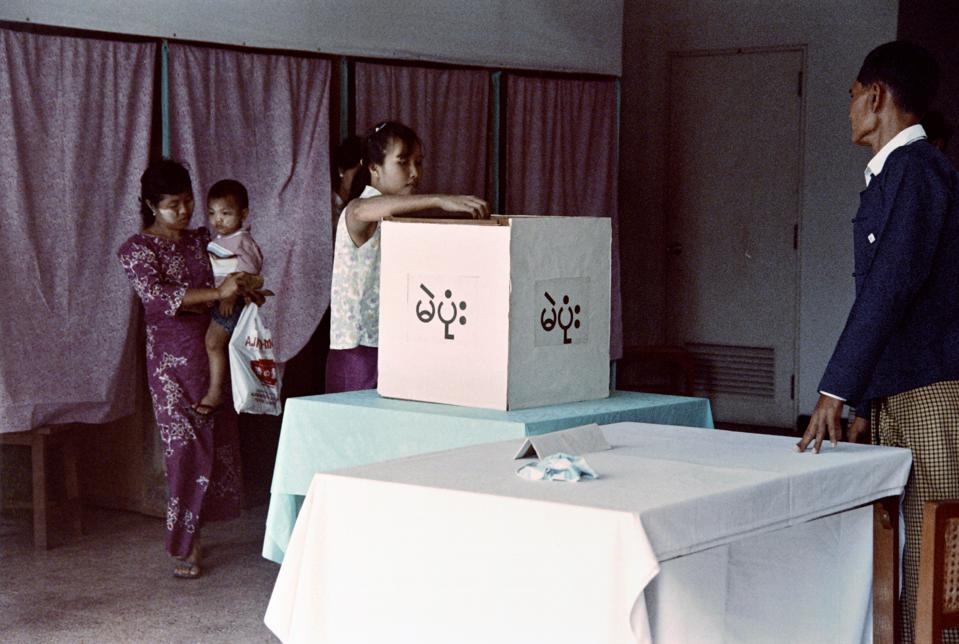 Voters cast their ballot at a polling pl