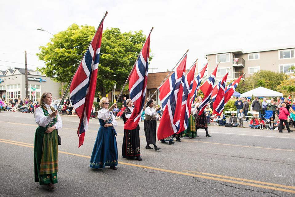 Flag-bearers carry the flag of Norway in the May 17 parade in Seattle.