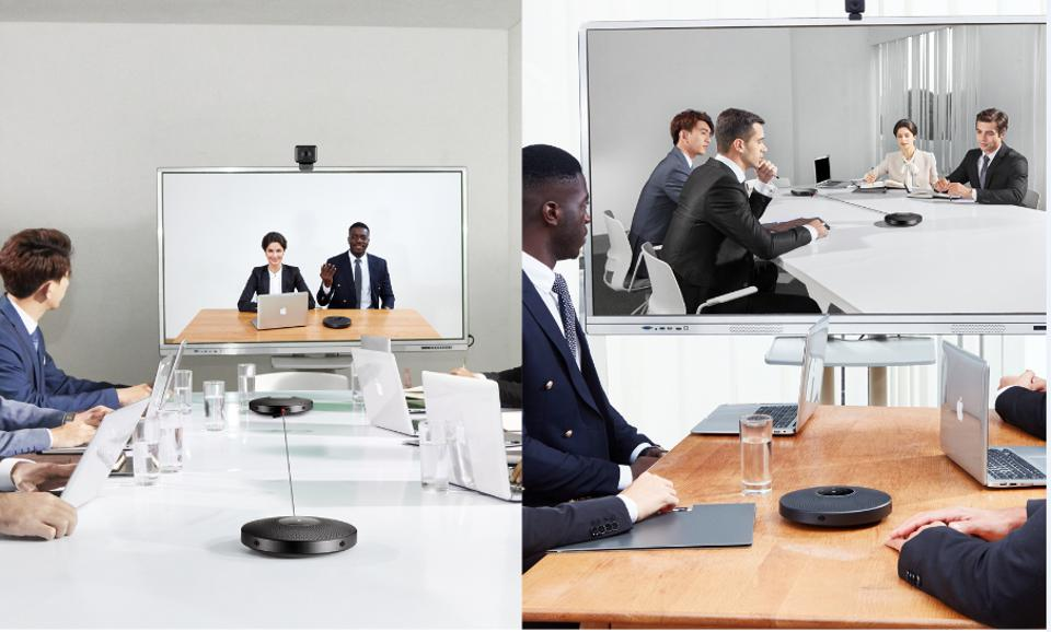 Photo of people taking part in a video conference with the eMeet M2Max on the table