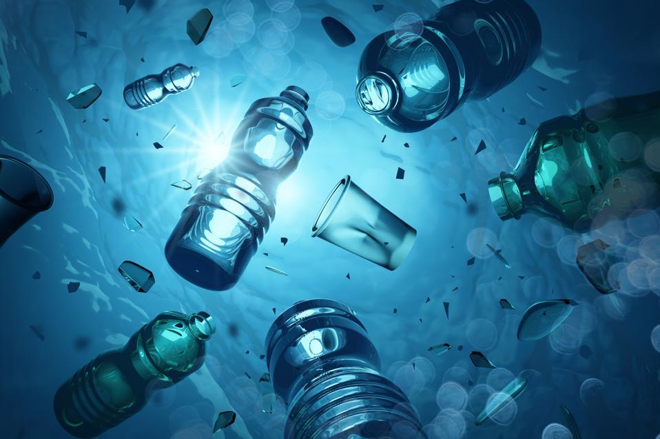 Single-use plastics floating in the ocean.