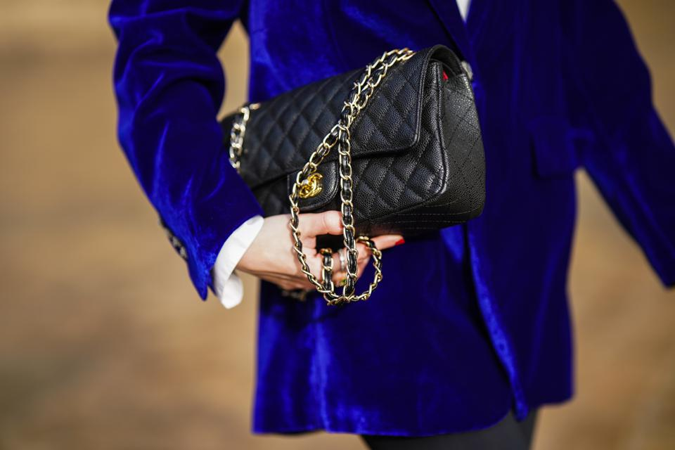 Chanel's signature quilted handbags command high prices in the secondary market. (Photo by Edward Berthelot/Getty Images)