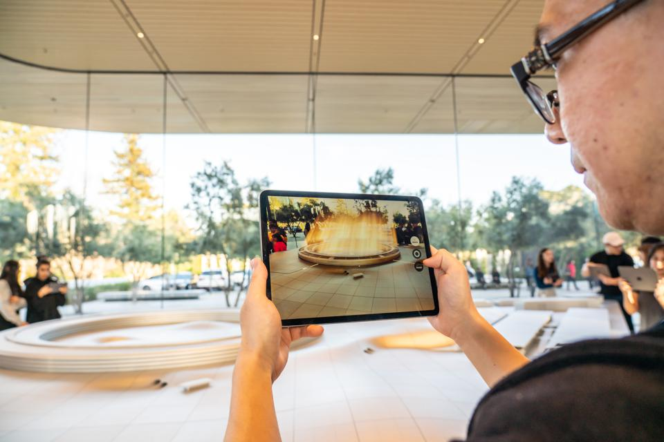 A customer using an iPad for an augmented reality (AR) tour...