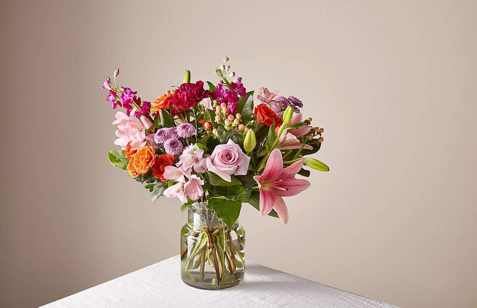 Valentine's bouquet with pink and orange roses, Peruvian lilies, purple carnations