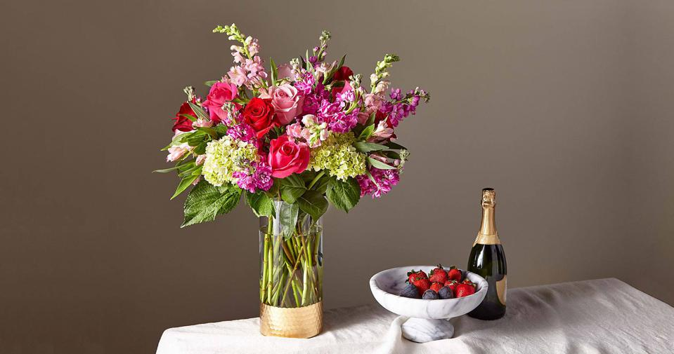 A lush bouquet of hydrangea, roses, and stock