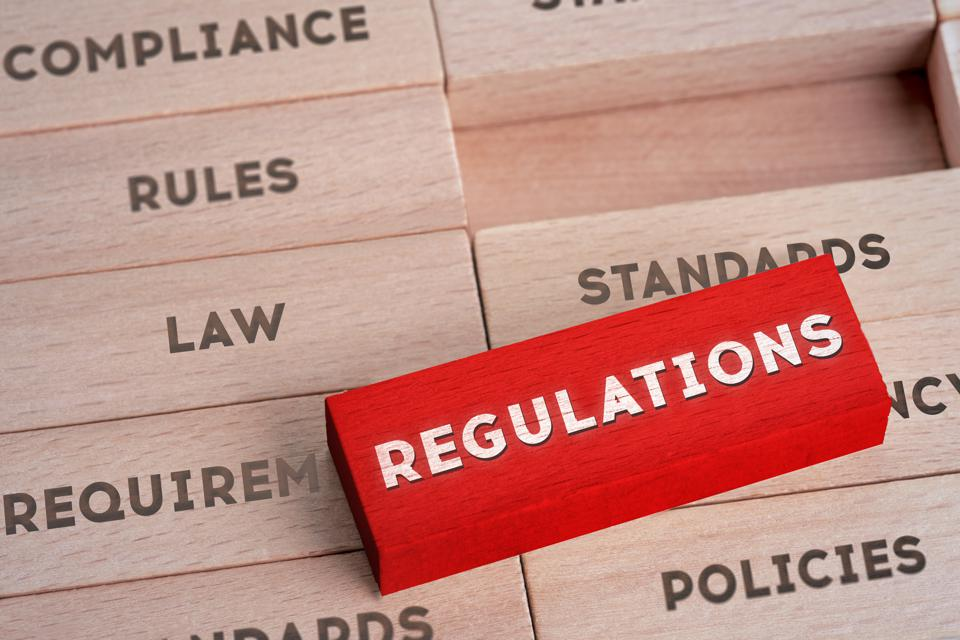 Regulations Concept with Wooden Blocks in Red Color