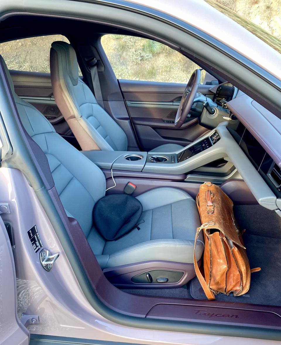 Taycan interior fits the norms of the German Sports Sedan genre.