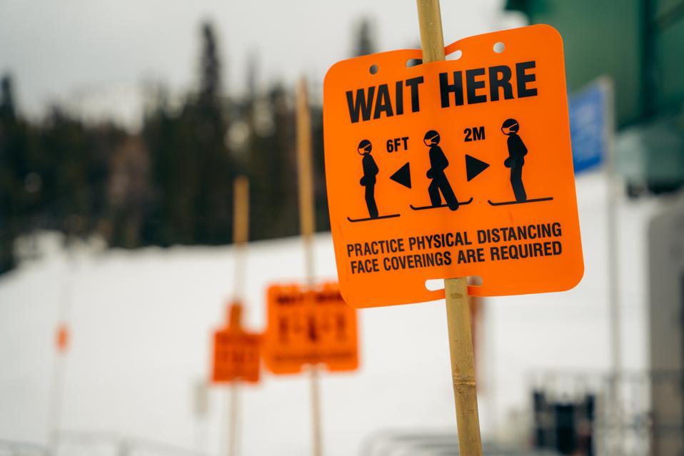 Social distancing signs at the Strawberry Lift at Banff Sunshine Village in Banff, Alberta