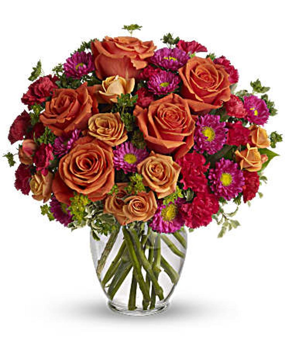 Orange roses with pink and green accent flowers