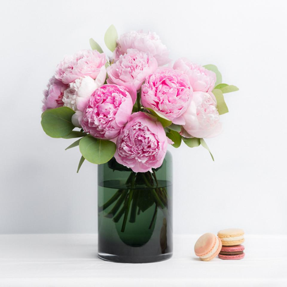 Pink peonies in a green glass vase