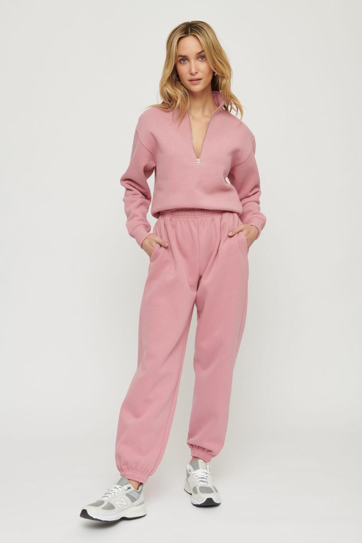 Relaxed half-zip sweatshirt and soft, oversized fleece joggers
